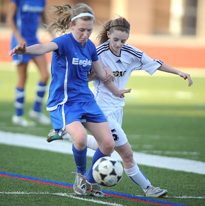 Broomfield's Ellie Milner fights for control of the ball withLegacy's Michaela Vadeboncoeur during Thursday's game at North Stadium.  March 15,  2012  staff photo/ David R. Jennings