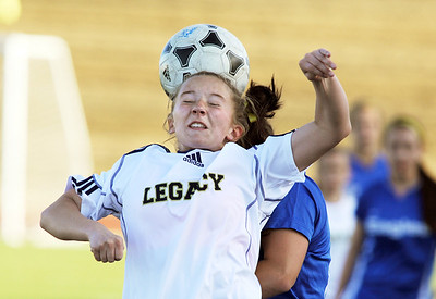 Legacy's Mady Huber does a header past Broomfield's Kerri Marquardt during Thursday's game at North Stadium.  March 15,  2012  staff photo/ David R. Jennings