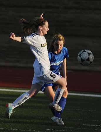 Legacy's Eva Tucker fights for control of the ball with Broomfield's Katie Forsee during Thursday's game at North Stadium.<br /> <br /> March 15,  2012 <br /> staff photo/ David R. Jennings