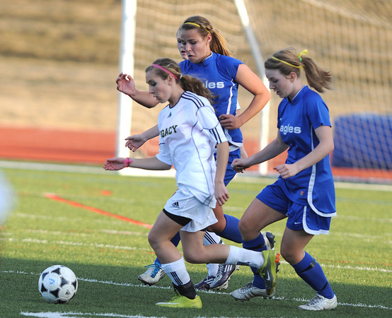 Legacy's Kelsey Kilean takes control of the ball against Broomfield's during Thursday's game at North Stadium.<br /> <br /> March 15,  2012 <br /> staff photo/ David R. Jennings