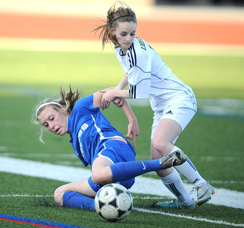 Legacy's Michaela Vadeboncoeur fights for control of the ball with Broomfield's Ellie Milner during Thursday's game at North Stadium.<br /> <br /> March 15,  2012 <br /> staff photo/ David R. Jennings