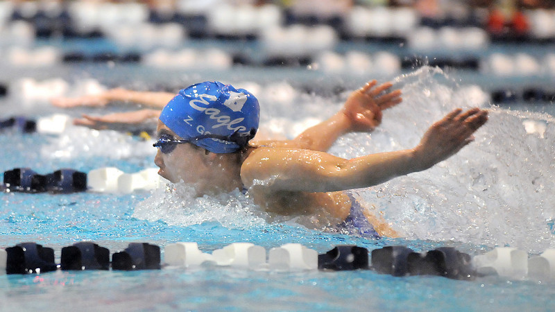 Broomfield's Zoe Gossett competing in the 100 yard butterfly event during Tuesday's Legacy vs. Broomfield swim meet at the Veterans Memorial Aquatic Center in Thornton.<br /> <br /> January 25, 2011<br /> staff photo/David R. Jennings