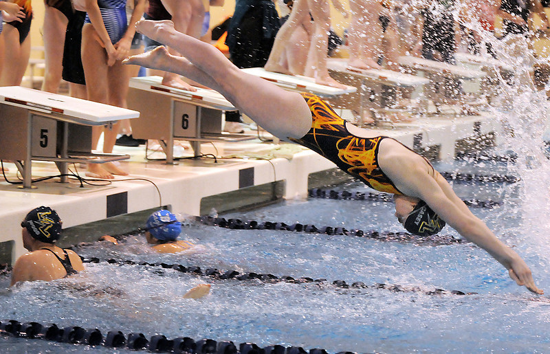 Legacy's Meghan Casey launches off the blocks as Rachel Wood finishes while competing in the 200 yard freestyle relay event during Tuesday's Legacy vs. Broomfield swim meet at the Veterans Memorial Aquatic Center in Thornton.<br /> <br /> January 25, 2011<br /> staff photo/David R. Jennings