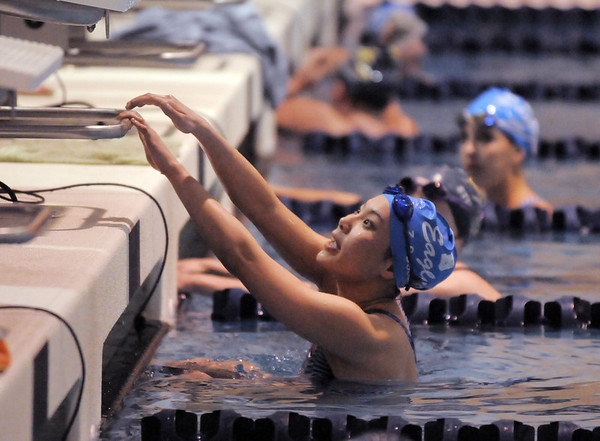 Zoe Gossett prepares to get out of the water after competing in the 100 yard butterfly event during Tuesday's Legacy vs. Broomfield swim meet at the Veterans Memorial Aquatic Center in Thornton.<br /> <br /> January 25, 2011<br /> staff photo/David R. Jennings