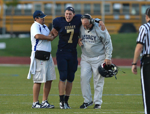 Legacy's coaches help quarterback Patrick Medina after he was injured during Friday's game against Chaparral at North Stadium.<br /> September 14, 2012<br /> staff photo/ David R. Jennings
