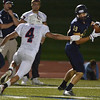 Legacy's Mitch McCall catches a pass as Chaparral's Roman Yancey advances during Friday's game at North Stadium.<br /> September 14, 2012<br /> staff photo/ David R. Jennings