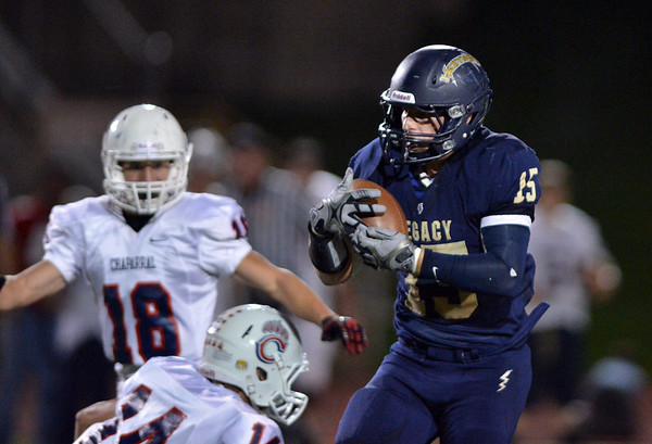 Legacy's Jake Bublitz catches the ball against Chaparral's Dallas Dobbs during Friday's game at North Stadium.<br /> September 14, 2012<br /> staff photo/ David R. Jennings