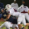 Legacy's Phydell Paris is tackled by Chaparral's Keenan Foshe during Friday's game at North Stadium.<br /> September 14, 2012<br /> staff photo/ David R. Jennings