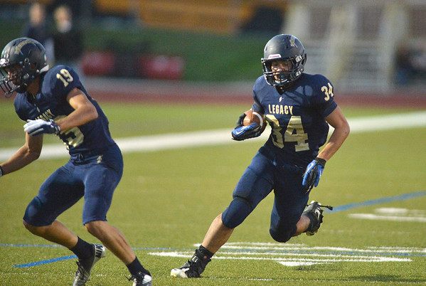 Legacy's Phydell Paris carries the ball downfield against Chaparral during Friday's game at North Stadium.<br /> September 14, 2012<br /> staff photo/ David R. Jennings
