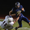 Legacy's Chase Cavill breaks a tackle by Chaparral's Blake Harris during Friday's game at North Stadium.<br /> September 14, 2012<br /> staff photo/ David R. Jennings