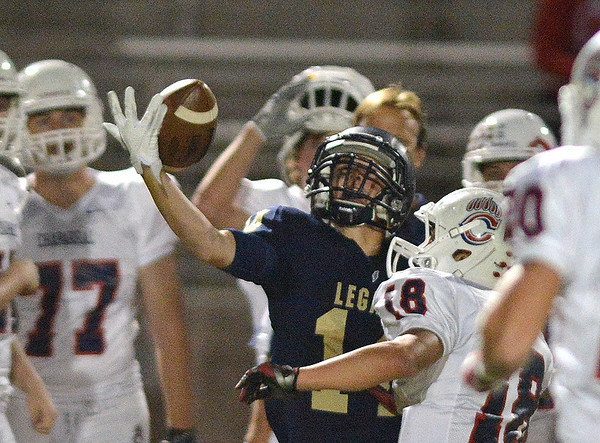 Legacy's Mitch McCall nearly catches a pass against Chaparral's Dustin Dobbs during Friday's game at North Stadium.<br /> September 14, 2012<br /> staff photo/ David R. Jennings
