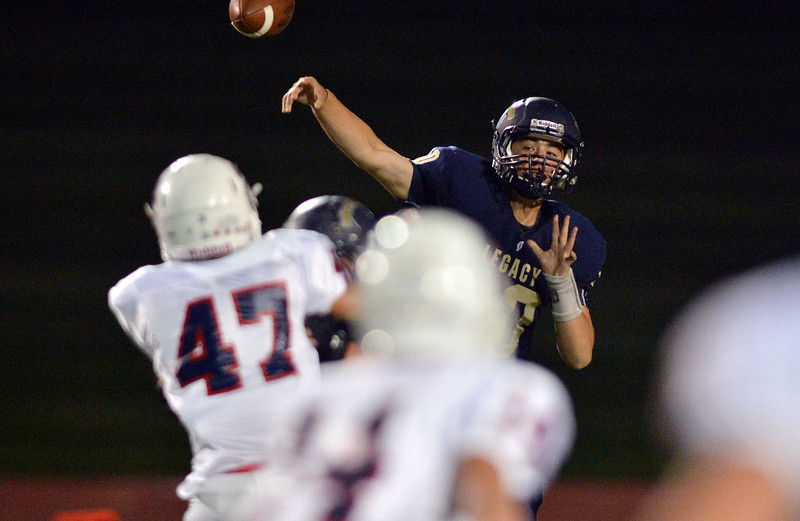 Legacy's quarterback Steven Yoshihara passes the ball against Chaparral during Friday's game at North Stadium.<br /> September 14, 2012<br /> staff photo/ David R. Jennings