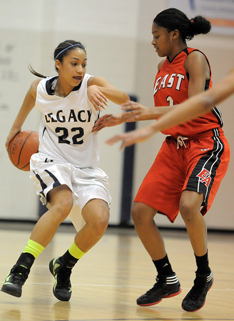 Legacy's Kailey Edwards dribbles the ball around her back past Denver East's Ke'Avae Taylor during Wednesday's state 5A playoff game at Legacy.<br /> February 29, 2012 <br /> staff photo/ David R. Jennings