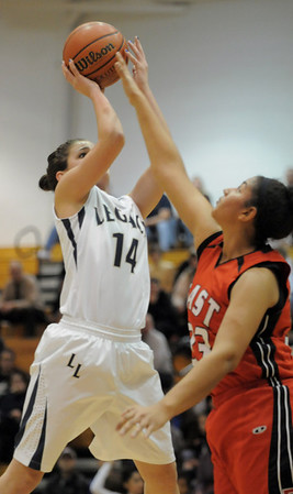 Legacy's Shayna Kuyper goes to the basket past Denver East's Tasha Carey during Wednesday's state 5A playoff game at Legacy.<br /> February 29, 2012 <br /> staff photo/ David R. Jennings
