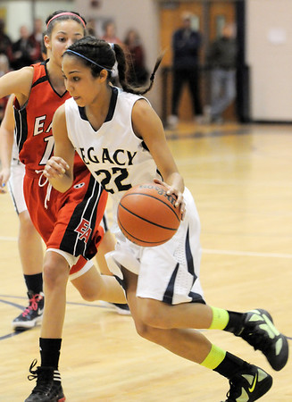 Legacy's Kailey Edwards drives the ball past Denver East's Asia Roper during Wednesday's state 5A playoff game at Legacy.<br /> February 29, 2012 <br /> staff photo/ David R. Jennings