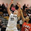 Legacy's Emily Glen goes to the basket against Denver East's Jau'Nae Peevy during Wednesday's state 5A playoff game at Legacy.<br /> February 29, 2012 <br /> staff photo/ David R. Jennings