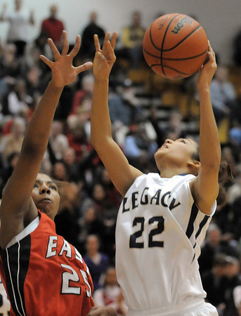Legacy's Kailey Edwards goes to the basket agaisnt Denver East's Jon'nae Richardson during Wednesday's state 5A playoff game at Legacy.<br /> February 29, 2012 <br /> staff photo/ David R. Jennings