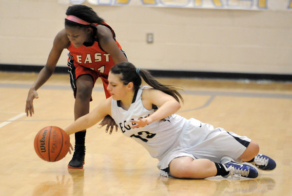 Legacy's Mackenzie Neely grabs a loose ball past Denver East's Asia Roper during Wednesday's state 5A playoff game at Legacy. <br /> For more photos please see broomfieldenterprise.com <br /> February 29, 2012 <br /> staff photo/ David R. Jennings