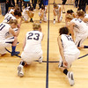 "The Legacy team does a ""Tebow"" at center court after defeating  Denver East in overtime at Wednesday's state 5A playoff game at Legacy.<br /> February 29, 2012 <br /> staff photo/ David R. Jennings"