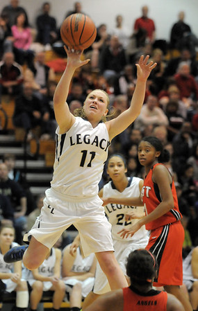 Legacy's Emily Glen goes to the basket against Denver East during Wednesday's state 5A playoff game at Legacy.<br /> February 29, 2012 <br /> staff photo/ David R. Jennings