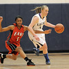 Legacy's Emily Glen avoids the reach of  Denver East's Ke'Avae Taylor during Wednesday's state 5A playoff game at Legacy.<br /> February 29, 2012 <br /> staff photo/ David R. Jennings