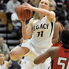 Legacy's Emily Glen goes to the basket against Denver East's Khadijah Vigil during Wednesday's state 5A playoff game at Legacy.<br /> February 29, 2012 <br /> staff photo/ David R. Jennings