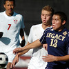 Legacy's Jacob Gonzales fights for control of the ball with Denver East's Elias Helbig during the quarterfinals at Denver All City Stadium on Thursday.<br /> <br /> <br /> <br /> November 3, 2011<br /> staff photo/ David R. Jennings