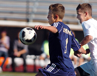 Legacy's Nick Smith fights for control of the ball with Denver East's Dakota Peterson during the quarterfinals at Denver All City Stadium on Thursday.    November 3, 2011 staff photo/ David R. Jennings