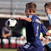 Legacy's Nick Smith fights for control of the ball with Denver East's Dakota Peterson during the quarterfinals at Denver All City Stadium on Thursday.<br /> <br /> <br /> <br /> November 3, 2011<br /> staff photo/ David R. Jennings