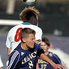 Legacy's Nick Smith goes up for a header against with Denver East's Dakota Peterson during the quarterfinals at Denver All City Stadium on Thursday.<br /> <br /> <br /> <br /> November 3, 2011<br /> staff photo/ David R. Jennings