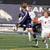 Legacy's Nathan Bradley moves the ball away from Denver East's Dakota Peterson during the quarterfinals at Denver All City Stadium on Thursday.<br /> <br /> <br /> <br /> November 3, 2011<br /> staff photo/ David R. Jennings
