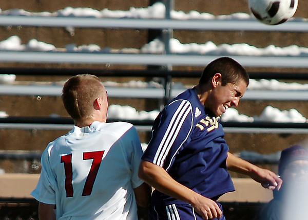 Legacy's Jacob Gonzales goes up against Denver East's Ian Curtis for a header during the quarterfinals at Denver All City Stadium on Thursday.<br /> <br /> <br /> <br /> November 3, 2011<br /> staff photo/ David R. Jennings