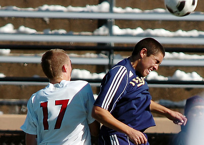 Legacy's Jacob Gonzales goes up against Denver East's Ian Curtis for a header during the quarterfinals at Denver All City Stadium on Thursday.    November 3, 2011 staff photo/ David R. Jennings