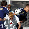 Legacy's Dresse Marrakchi, left, and Nick Smith goes for a header against Denver East's Dakota Peterson during the quarterfinals at Denver All City Stadium on Thursday.<br /> <br /> <br /> <br /> November 3, 2011<br /> staff photo/ David R. Jennings