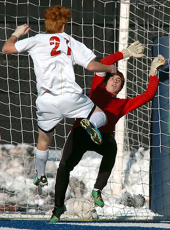 Legacy's Garrett Hernandez attempts to block the ball but Denver East's Jeremy Tabor kicked the ball to score the only point during the quarterfinals at Denver All City Stadium on Thursday.<br /> <br /> <br /> <br /> November 3, 2011<br /> staff photo/ David R. Jennings