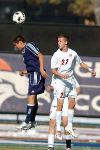 Legacy's Jacob Gonzales goes up for a header  against Denver East's Elias Helbig during the quarterfinals at Denver All City Stadium on Thursday.    November 3, 2011 staff photo/ David R. Jennings