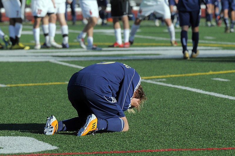 Legacy's Tanor Rainwater is upset over the 0-1 loss to Denver East during the quarterfinals at Denver All City Stadium on Thursday.<br /> <br /> <br /> <br /> November 3, 2011<br /> staff photo/ David R. Jennings