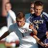 Legacy's Nick Smith fights to get to the ball with Denver East's Mitchell Heinzeroth during the quarterfinals at Denver All City Stadium on Thursday.<br /> <br /> <br /> <br /> November 3, 2011<br /> staff photo/ David R. Jennings
