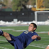 Legacy's Jacob Gonzales kicks the ball downfield past Denver East's Ian Curtis during the quarterfinals at Denver All City Stadium on Thursday.<br /> <br /> <br /> <br /> November 3, 2011<br /> staff photo/ David R. Jennings