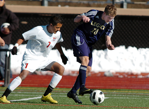 Legacy's John Hyatt dribbles the ball downfield against Denver East's Christian Delgadillo during the quarterfinals at Denver All City Stadium on Thursday.<br /> <br /> <br /> <br /> November 3, 2011<br /> staff photo/ David R. Jennings