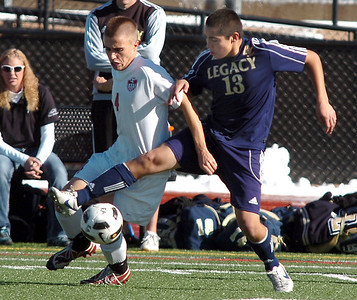 Legacy's Jacob Gonzales fights for control of the ball with Denver East's Caden MacKenzie during the quarterfinals at Denver All City Stadium on Thursday.    November 3, 2011 staff photo/ David R. Jennings