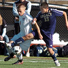 Legacy's Jacob Gonzales fights for control of the ball with Denver East's Caden MacKenzie during the quarterfinals at Denver All City Stadium on Thursday.<br /> <br /> <br /> <br /> November 3, 2011<br /> staff photo/ David R. Jennings