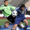 Legacy's Jacob Gonzales collides with Denver East's Tanner Drake and Ian Curtis at the goal during the quarterfinals at Denver All City Stadium on Thursday.<br /> <br /> <br /> <br /> November 3, 2011<br /> staff photo/ David R. Jennings