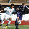 Legacy's John Hyatt fights to keep control of the ball with Denver East's Christian Delgadillo during the quarterfinals at Denver All City Stadium on Thursday.<br /> <br /> <br /> <br /> November 3, 2011<br /> staff photo/ David R. Jennings