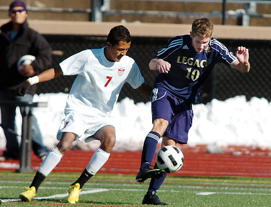 Legacy's John Hyatt fights to keep control of the ball with Denver East's Christian Delgadillo during the quarterfinals at Denver All City Stadium on Thursday.    November 3, 2011 staff photo/ David R. Jennings
