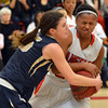 Legacy's Jenna Fenton holds the ball for a jump ball against Denver East's Khadijah Vigil during Friday's game at Denver East.<br /> March 1, 2013<br /> staff photo/ David R. Jennings