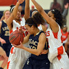 Legacy's Mackenzie Neelytries to get the ball past Denver East's Rhian Finley-Pond, left, and Jau'Nae Peevy during Friday's game at Denver East.<br /> March 1, 2013<br /> staff photo/ David R. Jennings