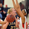 Legacy's Caitlyn Smith goes to the basket against Denver East's Rhian Finley-Pond during Friday's game at Denver East.<br /> March 1, 2013<br /> staff photo/ David R. Jennings