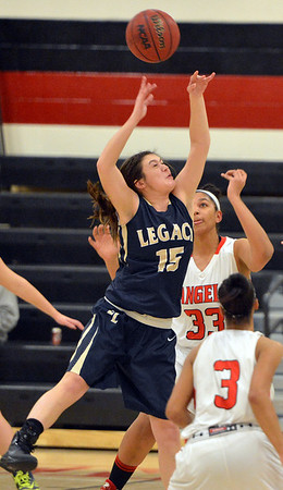 Legacy's Jenna Fenton goes up to rebound the ball against Denver East's Francesca Sally during Friday's game at Denver East.<br /> March 1, 2013<br /> staff photo/ David R. Jennings