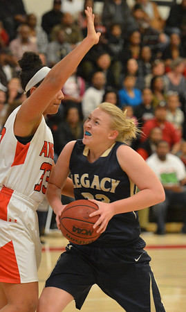 Legacy's Caitlyn Smith goes to the basket against Denver East's Francesca Sally during Friday's game at Denver East.<br /> March 1, 2013<br /> staff photo/ David R. Jennings